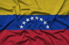 Venezuela flag is depicted on a sports cloth fabric with many folds. Sport team banner. Venezuela flag is depicted on a sports cloth fabric with many folds stock illustration