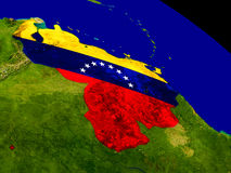 Venezuela with flag on Earth Royalty Free Stock Images