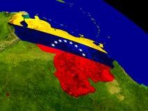 Venezuela with flag on Earth Stock Photos
