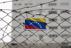 Venezuela flag on the fence of a jail. Venezuela flag waving on the fence of a jail royalty free stock photos