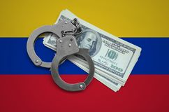 Venezuela flag with handcuffs and a bundle of dollars. Currency corruption in the country. Financial crimes.  royalty free stock photography