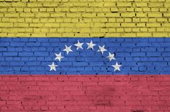 Venezuela flag is painted onto an old brick wall stock illustration