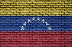 Venezuela flag is painted onto an old brick wall stock photos