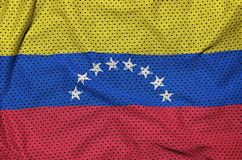 Venezuela flag printed on a polyester nylon sportswear mesh fabr. Ic with some folds royalty free stock photo