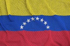 Venezuela flag printed on a polyester nylon sportswear mesh fabr. Ic with some folds stock photography