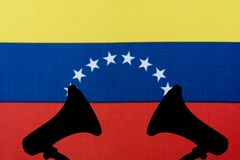 Venezuela flag and the silhouette of the speaker. The concept of the meeting and voice stock photos