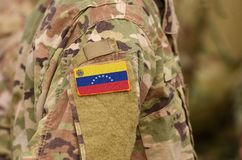 Venezuela flag on soldiers arm. Venezuela troops collage.  stock image