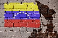 Venezuela flag on wall. Flags of Venezuela is painted on brick wall background royalty free stock photography