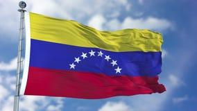 Venezuela flagga i en blå himmel Arkivbild