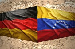 Venezuela and Germany. Waving Venezuelan and German flags on the of the political map of the world Stock Photo