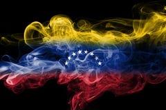 Venezuela smoke flag. Isolated on a black background stock photography