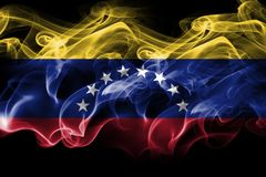 Venezuela smoke flag. Isolated on a black background royalty free stock photos