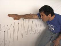 Venezuelan artist Elias Crespin with kinetic art work at his studio in Caracas Venezuela stock photos