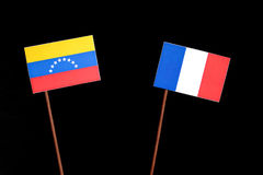 Venezuelan flag with French flag on black royalty free stock images
