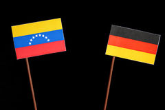 Venezuelan flag with German flag on black royalty free stock image