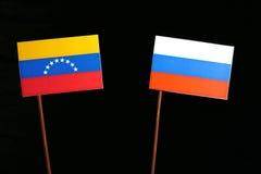 Venezuelan flag with Russian flag on black royalty free stock photo