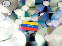 Venezuelan flag on top of CD and DVD pile isolated on white. Venezuelan flag on top of CD and DVD pile isolated Royalty Free Stock Photo
