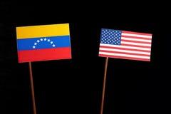 Venezuelan flag with USA flag on black. Background stock photos