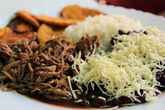 Venezuelan typical dish called Pabellon, made up of shredded meat, black beans, rice, fried plantain slices, and salty cheese. Royalty Free Stock Photos