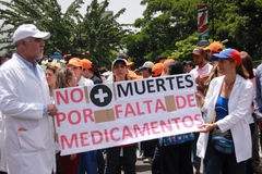 Venezuelans protest about medicine shortages. A protest last month in Caracas, Venezuela, over the country's hospital crisis, medicines are unavailable. The Royalty Free Stock Photos