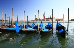 Venice. View to the island of San Giorgio Maggiore, in the foreground gondolas, Venice, Italy Royalty Free Stock Images