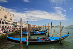 Venice. View of the sea​​, moored boats and gondolas Royalty Free Stock Photos