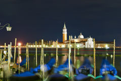 Venice. Traditional photo of Venice in the night with the Church of san Giorgio and the gondolas Royalty Free Stock Photography
