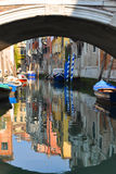 Venice. The colored houses of venice reflex in the canal under the bridge Royalty Free Stock Images