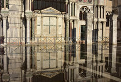 Venice Acqua Alta. Saint Mark Basilica southern facade reflection during Venice high tide, with its ancient polychrome marbles Royalty Free Stock Images