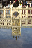 Venice Acqua Alta. Saint Mark Clock tower reflection during high tide in Venice Stock Photography