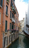 Venice alleyways. Narrow canal and alleys in Venice, Italy Royalty Free Stock Photo