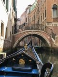 Venice. Ancient city and lovers in gondola Stock Photos
