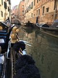 Venice. Ancient city and lovers in gondola Royalty Free Stock Photo