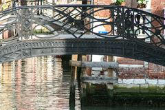 Venice, ancient wrought iron bridge stock photography