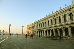VENICE - APRIL 13: Piazza San Marco with tourists on April 13, 2015 in Venice. It's the principal public square of Venice, Italy Royalty Free Stock Photo