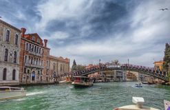 VENICE -. April16 2015: Rialto Bridge Ponte Di Rialto on a cloudy day on April 16 2015 in Venice. It`s oldest and one of the four bridges spanning the Grand Stock Photo