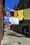 VENICE - APRIL 10, 2017: The view on alley in Venice. Laundry dr Stock Images