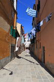 VENICE - APRIL 10, 2017: The view on alley in Venice. Laundry dr Stock Photos