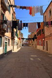 VENICE - APRIL 10, 2017: The view on alley in Venice. Laundry dr Stock Photography