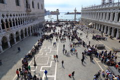 VENICE - APRIL 9, 2017: The view on San Marco Square with touris. Ts near the Doge Palace, on April 9, 2017 in Venice, Italy Stock Photos