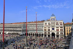 VENICE - APRIL 9, 2017: The view on San Marco Square with touris. Ts near the Zodiac Clock Tower, on April 9, 2017 in Venice, Italy Royalty Free Stock Photos