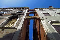 Venice architecture looking up, Italy. Looking up to the roofs and sky. Traditional Italian street Royalty Free Stock Photos