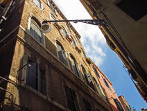 Venice architecture looking up, Italy. Looking up to the roofs and sky. Traditional Italian street Stock Image
