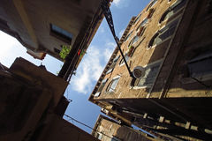 Venice architecture looking up, Italy. Looking up to the roofs and sky. Traditional Italian street Royalty Free Stock Photography
