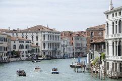 Venice architecture over Canale Grande. Full of boats during sunny day royalty free stock images