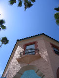 Venice Architecture & Palms. Detail of Venice, FL building with palms against blue sky stock photography