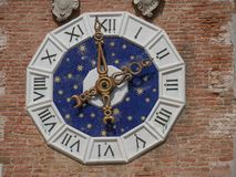 Venice - Arsenal. Arsenal in Venice is an example of pre industrial factory where weapons and ships were built by miles of workers. The clock royalty free stock photos