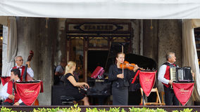 VENICE August 25. Musicians on the terrace of the world famous C Royalty Free Stock Images
