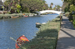Venice Beach canal with boat and bridge Royalty Free Stock Image