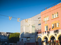 Venice Beach Sign. Early dawn view of Venice sign on Pacific Avenue near Venice Beach Boardwalk facing West towards the Pacific Ocean Royalty Free Stock Images